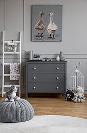 Pouf on round rug in grey kid's room int