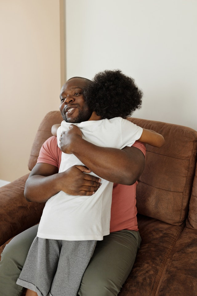 African American Child Hugging His Father