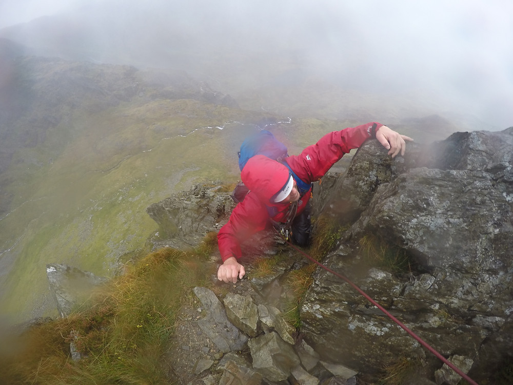 Nearing the top of a wet and windy Cneifion Arete