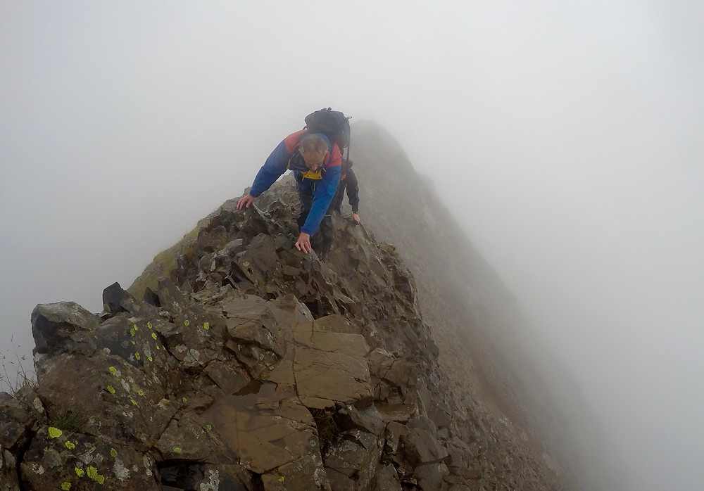 Scrambling along the exposed and narrow initial section.