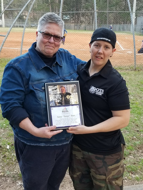 Sarge plaque and Lindsey.jpg