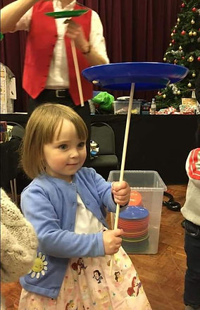 party photo of girl plate spinning.jpg