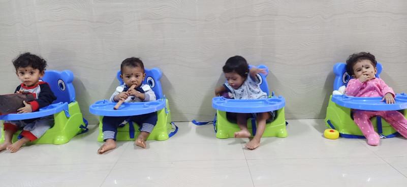 YOUNG BABIES ON  FOOD TABALE AT ASHRAM