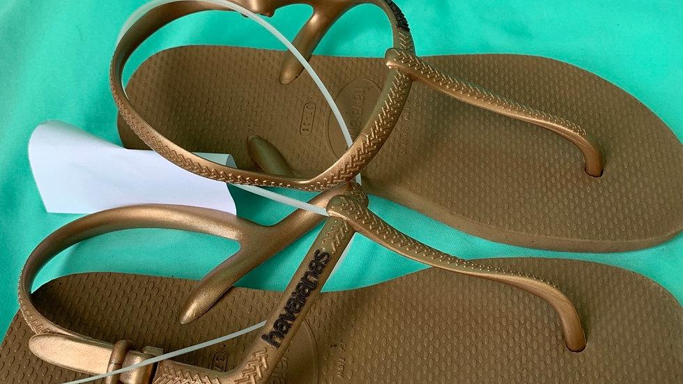 Big kid size 7, havaianas gold sandals