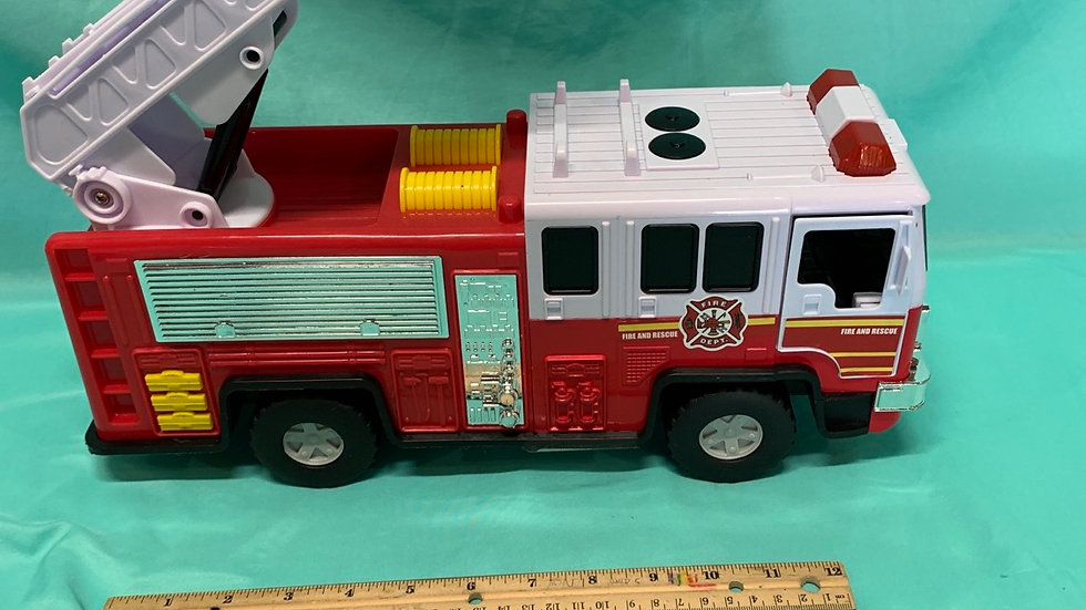 Big fire truck with four buttons for sound and lights