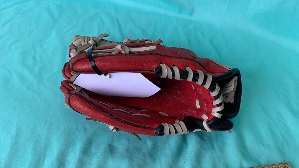Red left handed baseball glove ages six and up