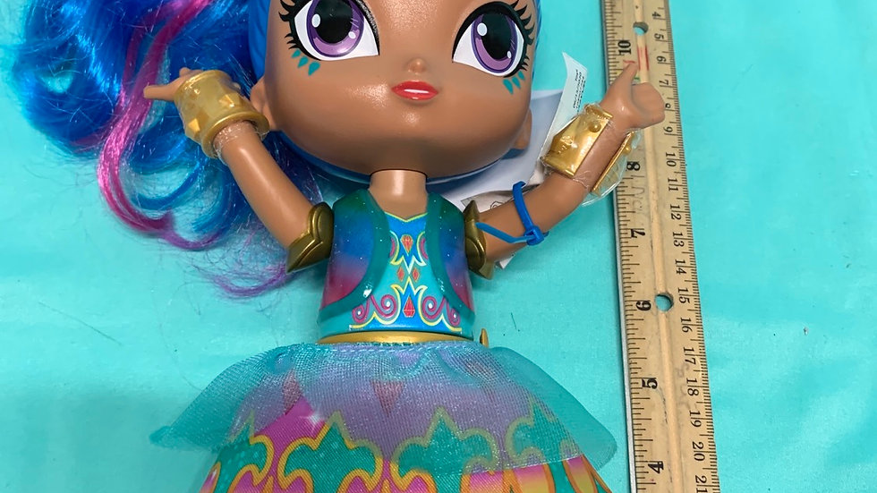 Shimmer and shine blue genie doll singing, retractable skirt