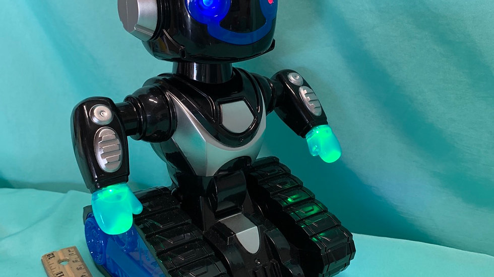 Robot, blue, black, lights up and moves back-and-forth