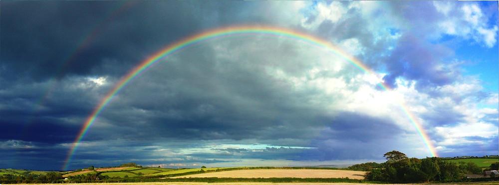 rainbow over blue sky