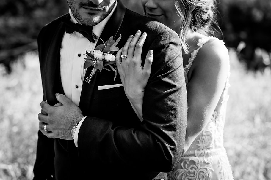 Black and White photograph of a beautiful Bride and Groom sharing a embrace in Winnipeg, Manitoba. Lensed by Cynthia Bettencourt Photography