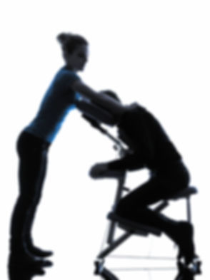 one man and woman performing chair massa
