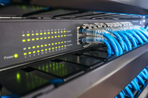 Network switch and ethernet cables in ra