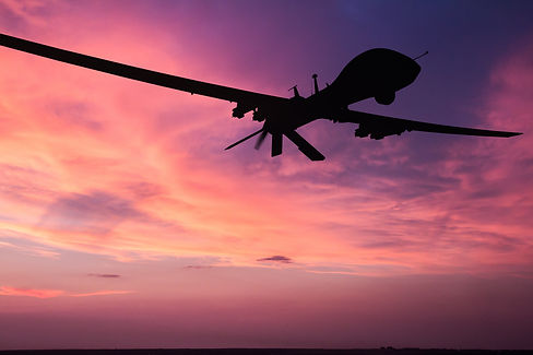 Military drone silhouette  on sunset bac