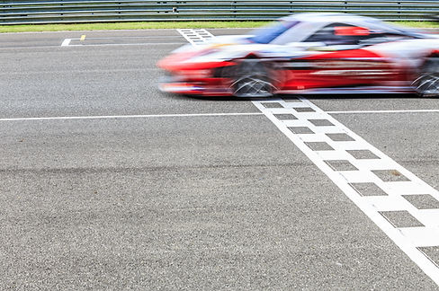 Race car crossing the finish line on a c