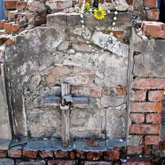 After Katrina, Little Wooden Cross on Brick Grave