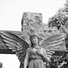 Angel Standing Against the Cross