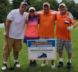 Brandon's dad (Brad) and Brad's girlfriend (Jody) golf every year in the tournament and Brad owns a plumbing/heating business so he sponsors a hole each year also.