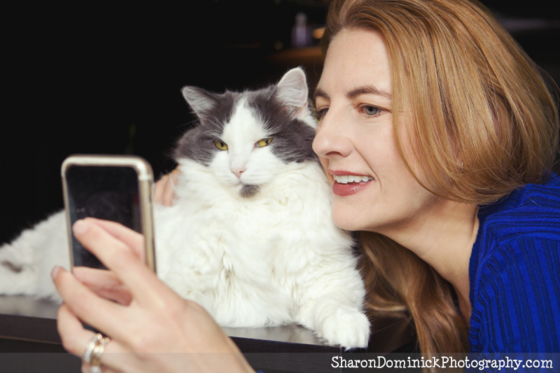 Woman taking a selfie with her cat