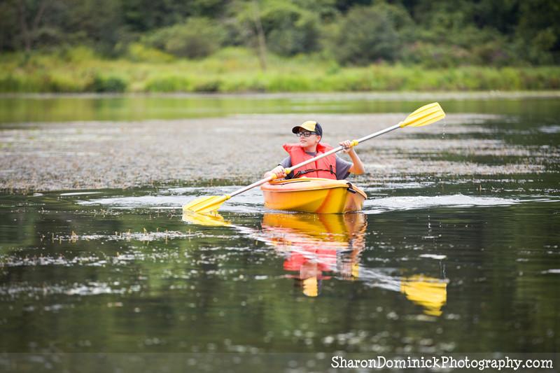 teen boy in kayak