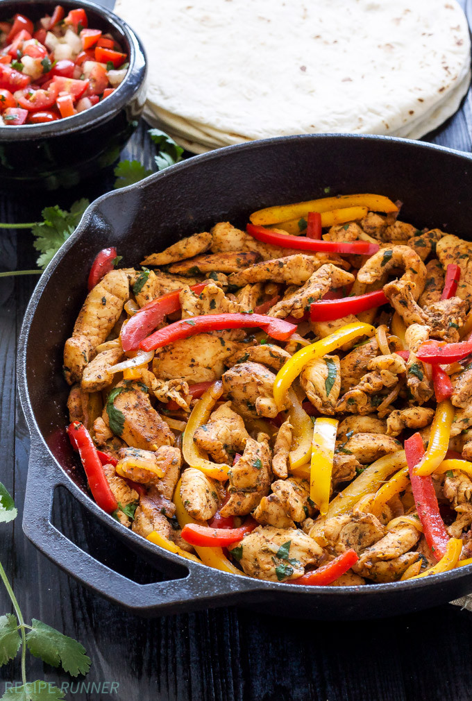 chicken fajitas in a skillet with peppers