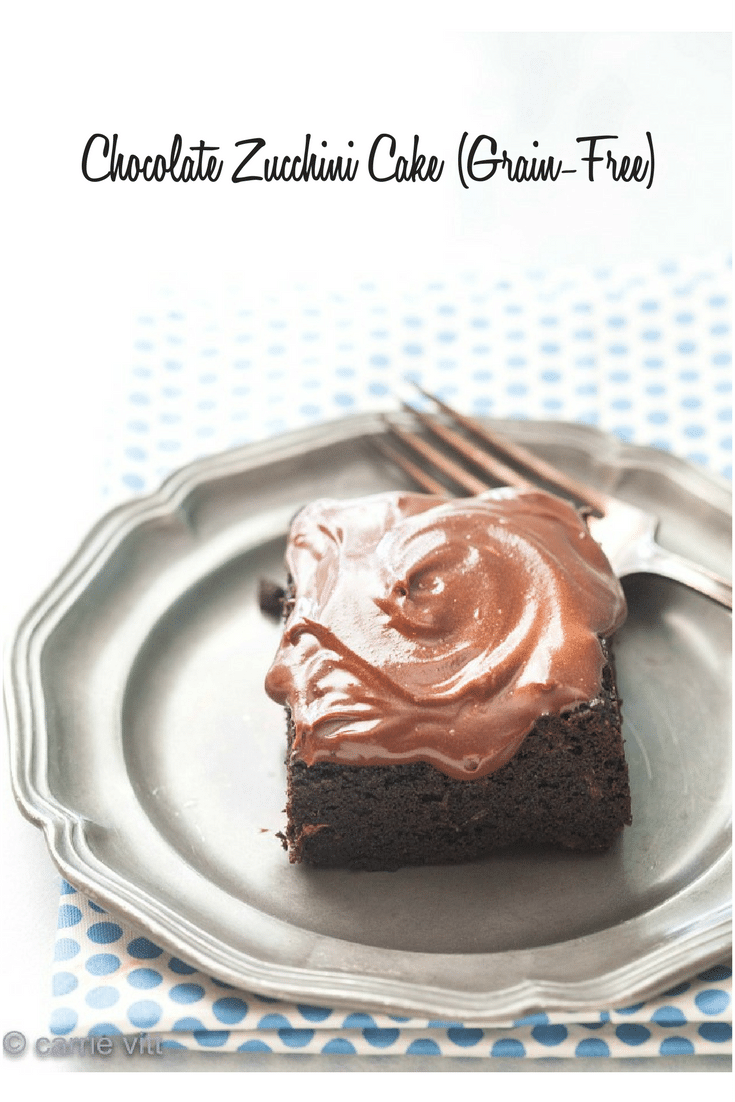 a piece of chocolate zucchini cake with chocolate frosting on a plate