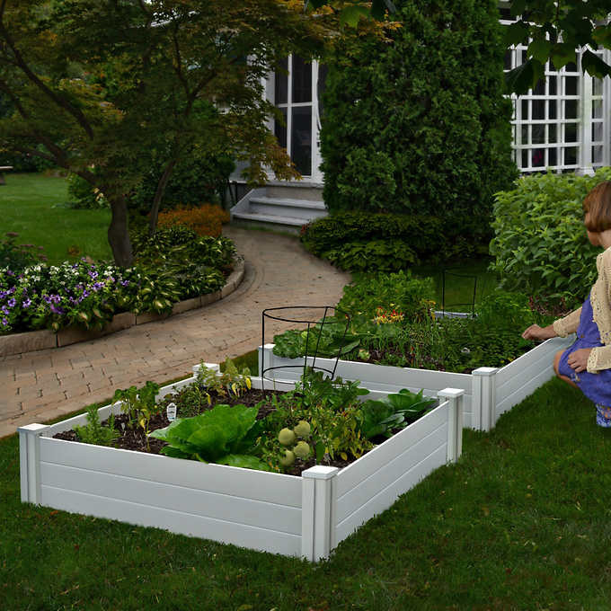 picture of two raised garden beds to easily grow vegetables and herbs wherever you live