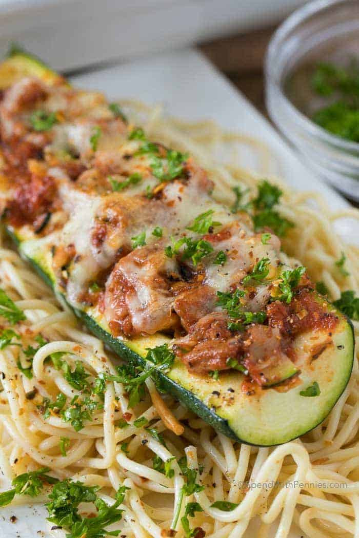 stuffed zucchini boats over spaghetti for dinner
