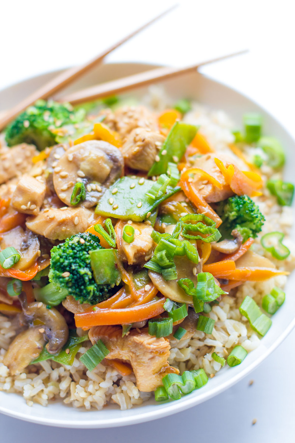 chicken vegetables on rice in a bowl