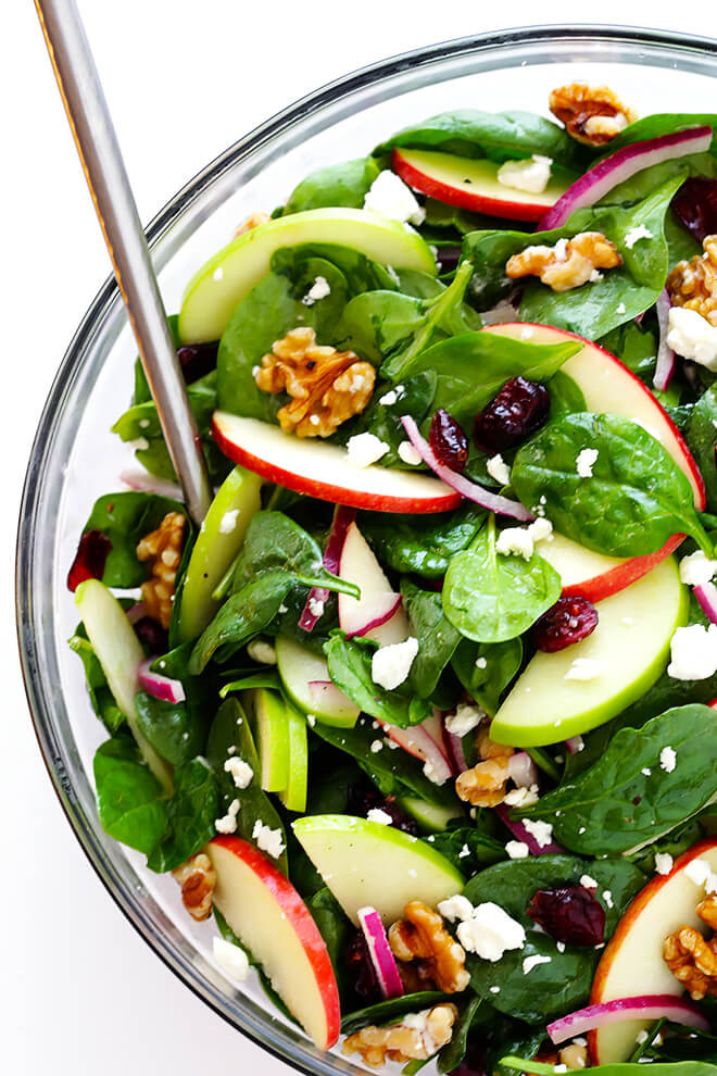 easy spinach and apple salad in a glass bowl