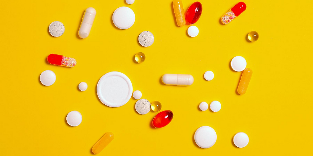 vitamins and dietary supplements on a yellow background