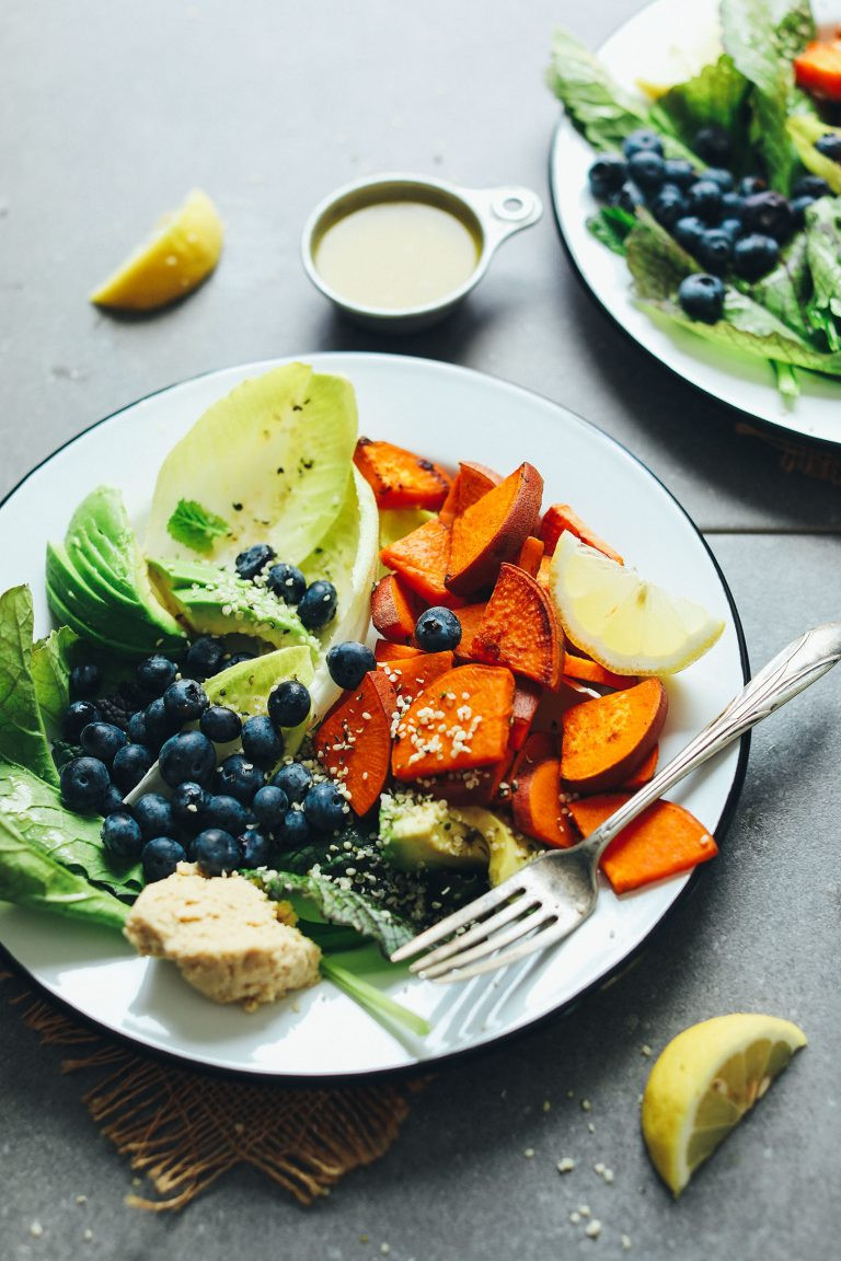 salad for breakfast with sweet potatoes blueberries hummus and greens