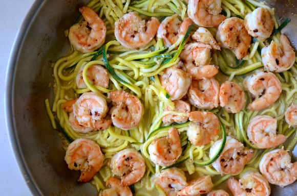 shrimp in a skillet on zucchini noodles
