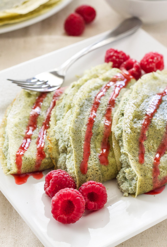 matcha crepes with raspberry sauce on a plate