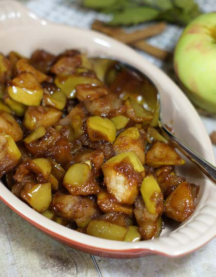 baked apples in a dish with cinnamon