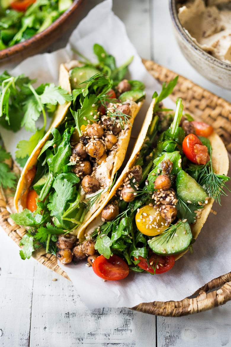 middle eastern salad tacos are a great way to have a plant based meal or serve meat on the side for those who must have it