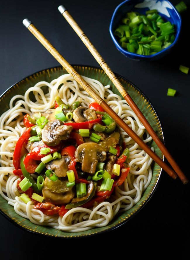 mushroom stir fry in a bowl with noodles
