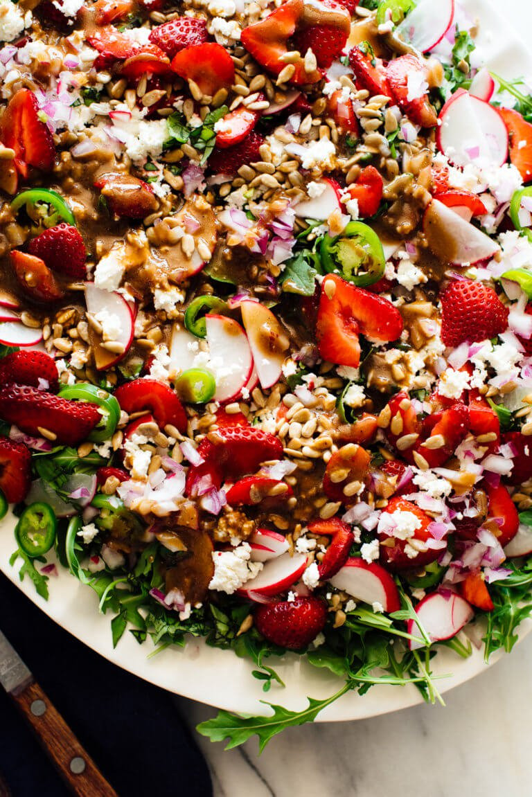 strawberry salad with jalapeno sunflower seeds arugula