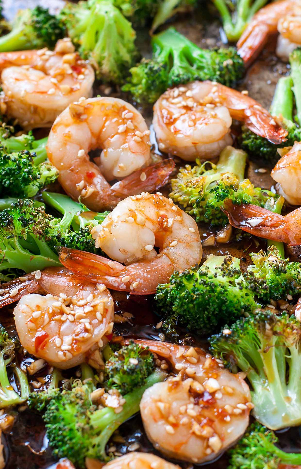 shrimp and broccoli on a sheet pan