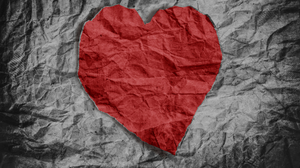 an image of a crumpled paper with a picture of a heart