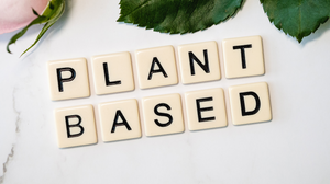 the words plant based spelled out in scrabble letters