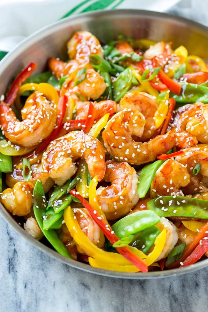 shrimp stir fry in a pan with vegetables