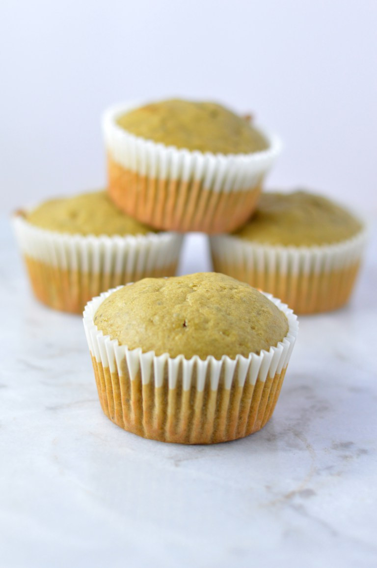 matcha muffins in muffin wrappers on a table