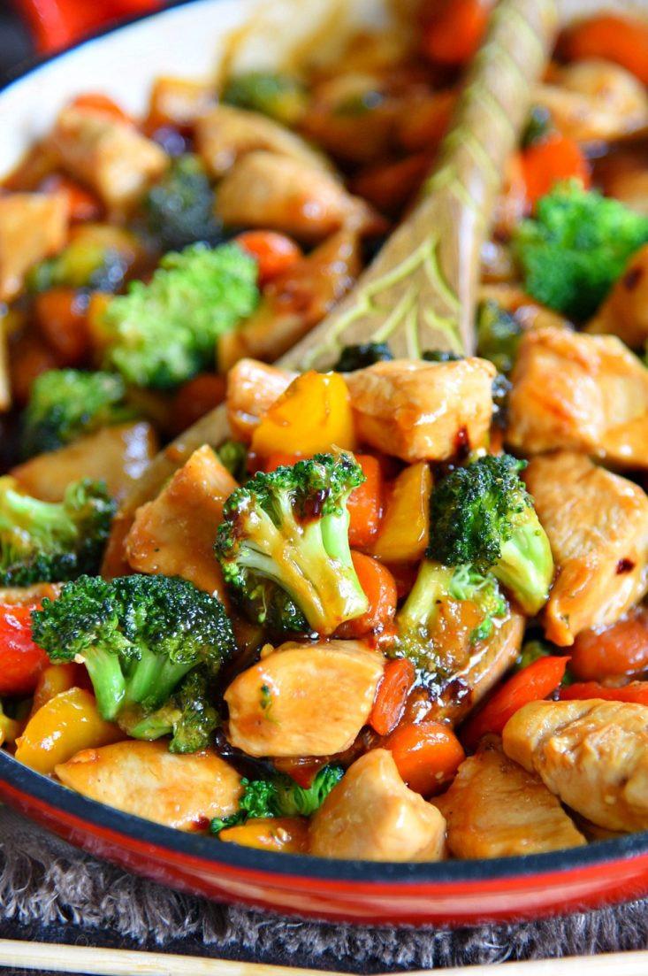 chicken stir fry with vegetables in a pan