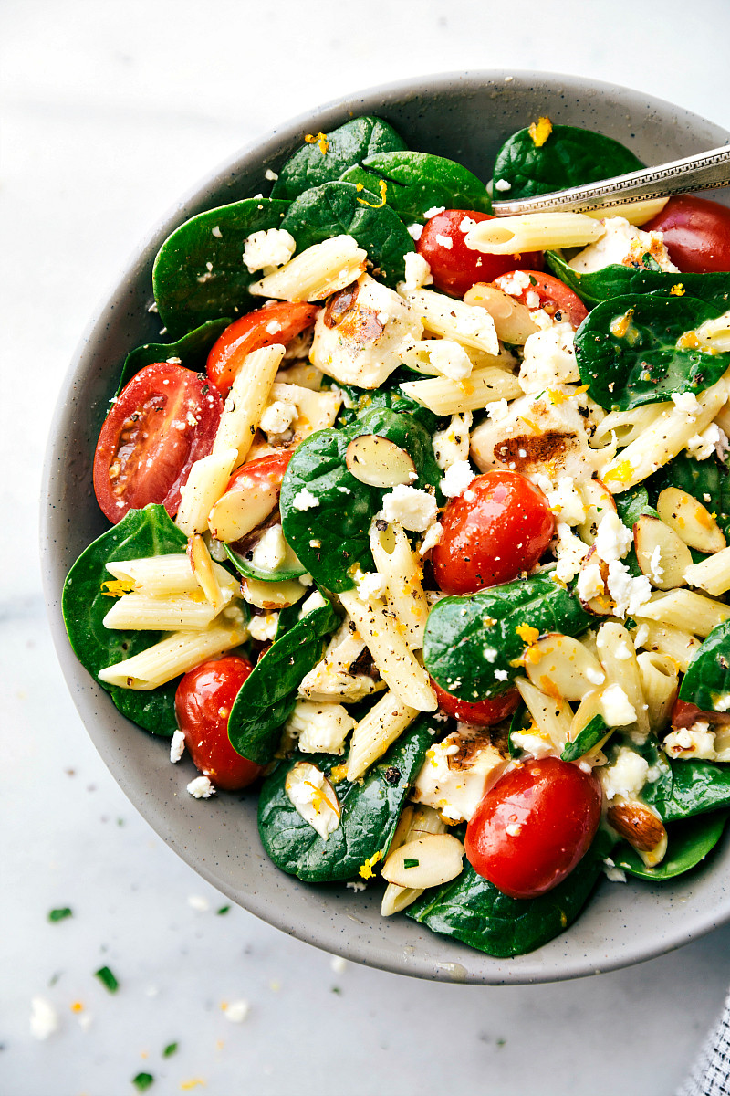 healthy chicken spinach pasta salad in a bowl