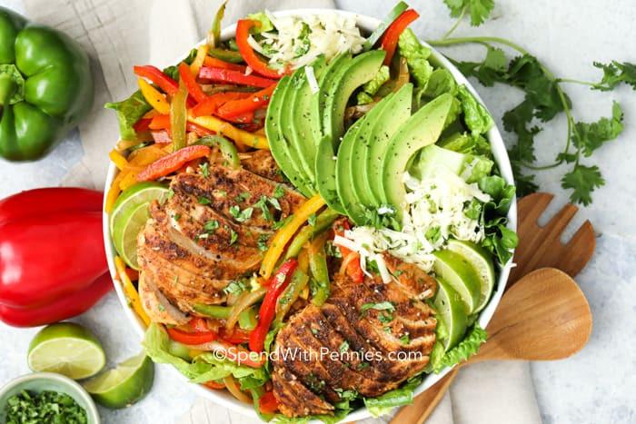 chicken fajita salad recipe in a bowl with avocado