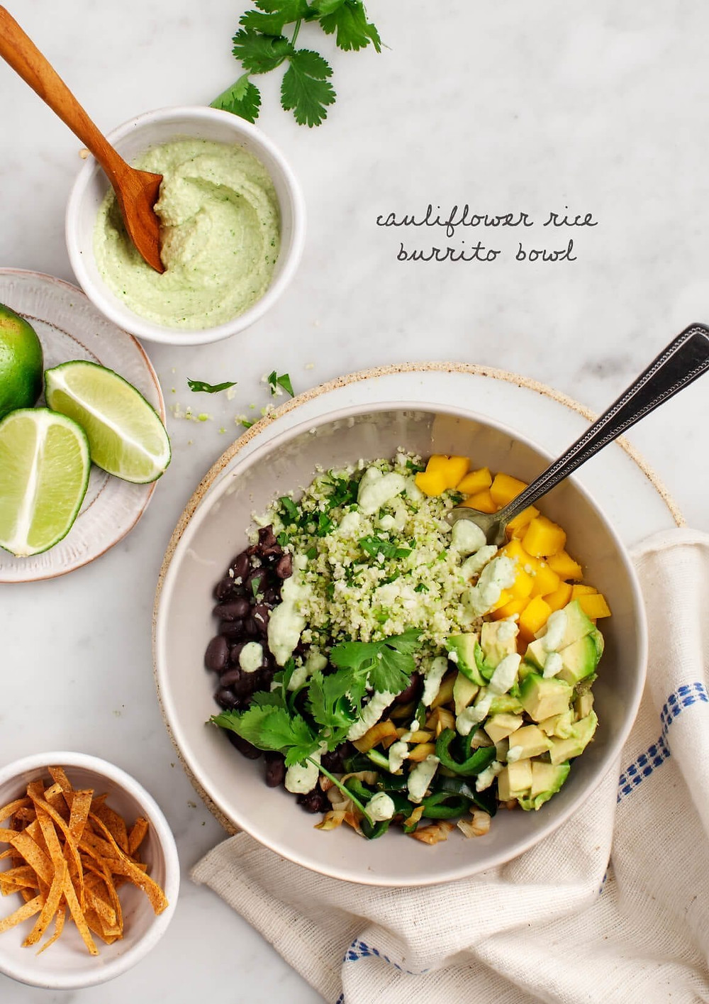 cauliflower rice burrito bowl is full of vegetables and beans making it a satisfying meatless dinner