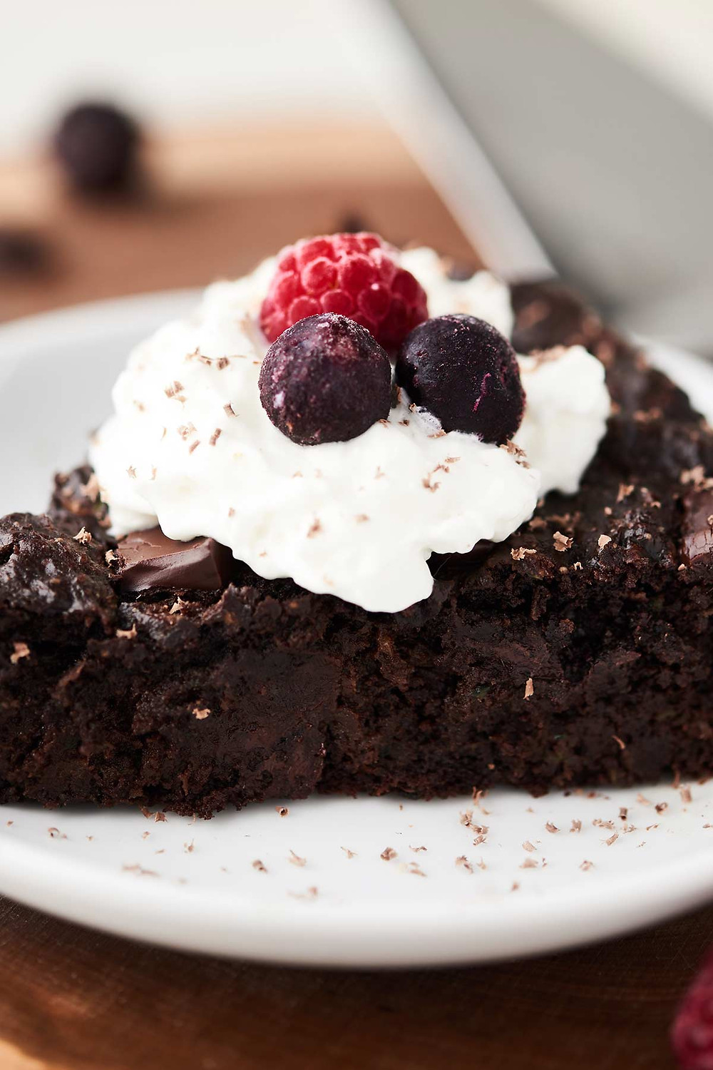 healthy chocolate zucchini cake with berries on top