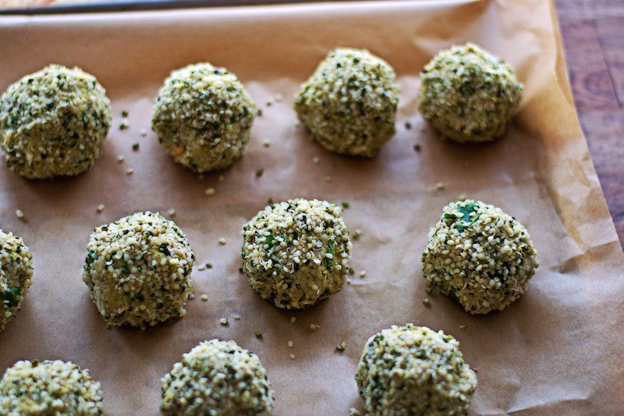hemp falafel on parchment paper on a tray