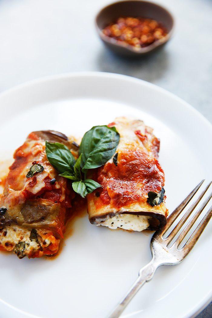 eggplant lasagna with tomato sauce and basil on a plate