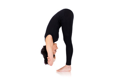 woman practicing standing forward bend
